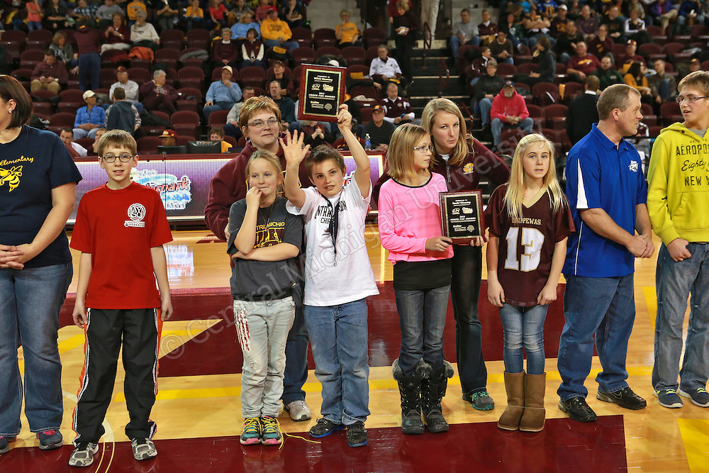 Sixteen area schools and the CMU campus collected food, personal care items and cash donations, with all of the food going to the Greater Lansing Food Bank. The schools raised a grand total of 38,194 pounds of food that will feed thousands. The top collectors were Mt. Pleasant Sacred Heart and also Belding Middle School. The schools were honored at halftime of the CMU-Prarie View A&amp;M women's basketball game Wednesday. <br /> <br /> Central Michigan University photo by Steve Jessmore