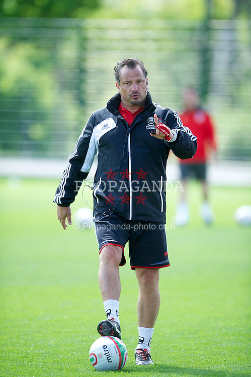 NEWPORT, WALES - Wednesday, May 22, 2013: Dean Holdsworth gives a practical demonstration during the Football Association of Wales' UEFA Pro Licence Course 2013 at Dragon Park. (Pic by David Rawcliffe/Propaganda)