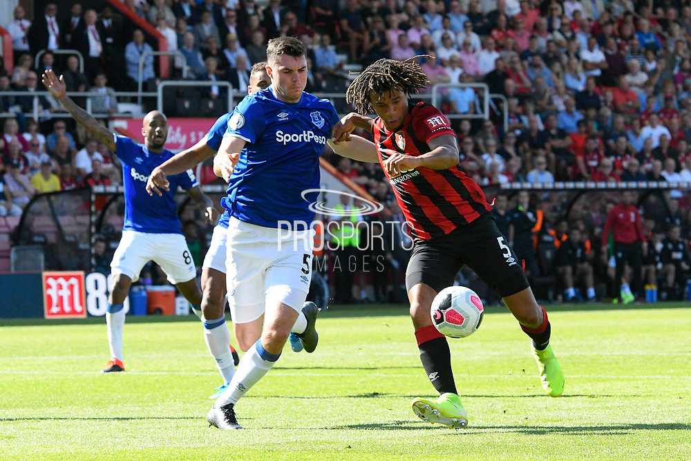 Nathan Ake (5) of AFC Bournemouth lines up a shot at goal as Michael Keane (5) of Everton challenges him during the Premier League match between Bournemouth and Everton at the Vitality Stadium, Bournemouth, England on 15 September 2019.