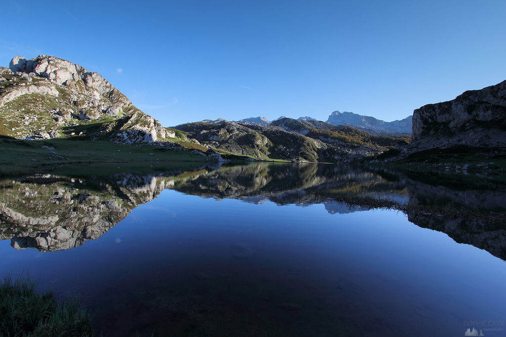 Perfect reflections in Lago de la Ercina in the Picos de Europa in northern Spain