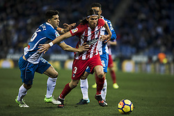 December 22, 2017 - Barcelona, Spain - BARCELONA, SPAIN - DECEMBER 22:  03 Filipe Luis from Brasil of Atletico de Madrid defended by 15 David Lopez from Spain of RCD Espanyol during the match of La Liga Santander between RCD Espanyol v Atletico de Madrid, at RCD Stadium in Barcelona on 22 of December, 2017. (Credit Image: © Xavier Bonilla/NurPhoto via ZUMA Press)