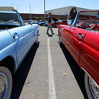 Thomas Wells | BUY at PHOTOS.DJOURNAL.COM<br /> Andy Bean of Fulton admires a pair of Ford Thunderbirds that are on display at this years Blue Suede Cruise at the BancoprSouth Arena on Friday.