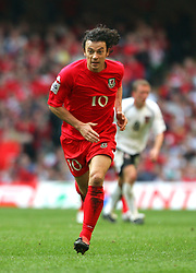CARDIFF, WALES - SATURDAY MARCH 26th 2005: Wales' Simon Davies in action against Austria during the Wold Cup Qualifying match at the Millennium Stadium. (Pic by David Rawcliffe/Propaganda)