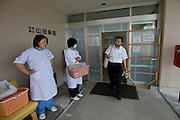 Dr. Sen Hiraizumi and two nurses, Fumie Ooi and Etsuko Noda, leave the Iwate Prefectural Hospital in Yamada town, Iwate Prefecture, Japan on  10 June 20011. With the prefectural hospital in Yamada badly damaged by the March 11 quake and tsunamis, hospital staff have followed Hiraizumi's lead to take their expertise to those in need. Robert Gilhooly photo
