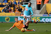Wolverhampton Wanderers striker Bjorn Sigurdarson fouls Derby County defender Marcus Olsson during the Sky Bet Championship match between Wolverhampton Wanderers and Derby County at Molineux, Wolverhampton, England on 27 February 2016. Photo by Alan Franklin.