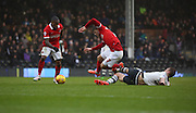 Fulham defender, Dan Burn (33) late tackle no Charlton Athletic midfielder, Johann Berg Gudmundsson (7) during the Sky Bet Championship match between Fulham and Charlton Athletic at Craven Cottage, London, England on 20 February 2016. Photo by Matthew Redman.