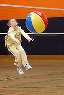 Middletown, N.Y. - A 7-year-old girl leaps to hit a beach ball at the volleyball station during National Women in Sports Day on Feb. 11, 2006. Orange County Community College's Department of Movement Science celebrated the 20th Anniversary of National Girls and Women in Sports Day by holding an event for young girls that included volleyball, basketball, soccer, games and swimming.