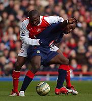 Photo: Daniel Hambury, Digitalsport<br /> Arsenal v Portsmouth.<br /> FA Barclays Premiership.<br /> 05/03/2005.<br /> Arsenal's Lauren and Portsmouth's Lua Lua battle for the ball.