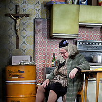 Gregor Fisher as 'Yer Granny' who is eating the family out of house and home.<br /> <br /> Yer Granny - a new production by The National Theatre of Scotland opens at the Beacon arts Centre, Greenock, Scotland.<br /> <br /> <br /> Based on La Nona by Roberto Cossa<br /> In a new version by Douglas Maxwell<br /> Directed by Graham McLaren<br /> <br /> <br /> Picture by Drew Farrell<br /> Tel : 07721-735041<br /> Image offered on a speculative basis.<br /> <br /> Yer Granny is a riotous new comedy about a diabolical 100-year-old granny who&rsquo;s literally eating her family out of house and home. She&rsquo;s already eaten their fish and chip shop into bankruptcy and now she&rsquo;s working her way through their kitchen cupboards, pushing the Russo family to desperate measures just to survive beyond 1977.<br /> <br /> As proud head of the family, Cammy is determined that The Minerva Fish Bar will rise again and that family honour will be restored &ndash; and all in time for the Queen&rsquo;s upcoming Jubilee visit. But before Cammy&rsquo;s dream can come true and before Her Maj can pop in for a chat, a single sausage and a royal seal of approval, the family members must ask themselves how far they will go to solve a problem like Yer Granny.<br /> <br /> Adapted from the smash-hit Argentinian comedy classic La Nona, the cast of Yer Granny features some of Scotland&rsquo;s best-loved performers, including Gregor Fisher in the title role, alongside Paul Riley (Still Game), Jonathan Watson (Only An Excuse?), Maureen Beattie (Casualty), Barbara Rafferty (Rab C Nesbitt), Brian Pettifer (The Musketeers) and Louise McCarthy (Mamma Mia!, West End).<br /> <br /> Performance dates :<br /> The Beacon Arts Centre, Greenock<br /> 19/05/2015&nbsp;-&nbsp;21/05/2015 <br /> <br /> King's Theatre, Glasgow<br /> 26/05/2015&nbsp;-&nbsp;30/05/2015 <br /> <br /> King's Theatre, Edinburgh<br /> 02/06/2015&nbsp;-&nbsp;06/06/2015 <br /> <br /> Eden Court, Inverness<br /> <br /> Lyric Theatre, B