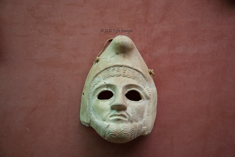 Open-eyed Roman theatrical mask on display at the Merida Archaeological Museum, Spain