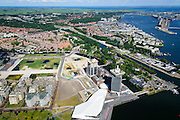 Nederland, Noord-Holland, Amsterdam-Noord, 01-08-2016; IJ-oevers en Overhoeks met A'DAM Toren (voormalige Shell-toren) en Eye filmmuseum (onder in beeld). Buiksloterweg  met  voormalige bedrijfskantine Shell en Tolhuistuin, ingang Noordhollands kanaal.<br /> Banks of IJ and Overhoeks with A'DAM Tower (former Shell Tower) and Eye Film Museum.<br /> luchtfoto (toeslag op standard tarieven);<br /> aerial photo (additional fee required);<br /> copyright foto/photo Siebe Swart