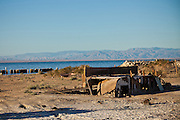 Remains of a trailer home Salt along the coast of the Salton Sea at sunrise Imperial Valley, CA.
