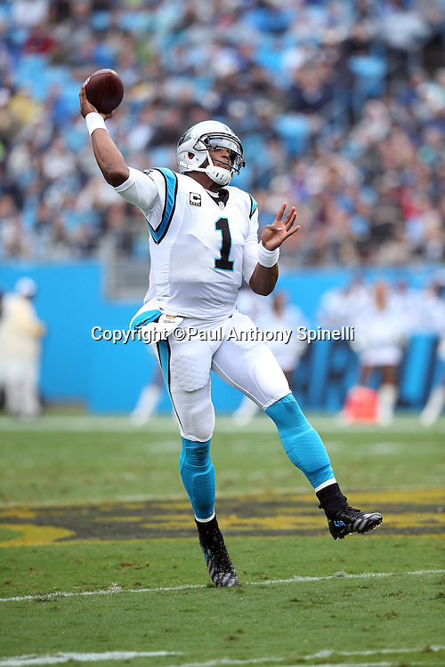 Carolina Panthers quarterback Cam Newton (1) throws a first quarter pass off his back foot during the 2015 NFL week 3 regular season football game against the New Orleans Saints on Sunday, Sept. 27, 2015 in Charlotte, N.C. The Panthers won the game 27-22. (©Paul Anthony Spinelli)
