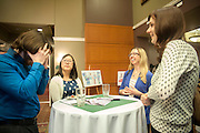 Brett Ankawi, Clare Ankawi, Jennifer Kowalksy and Kristen Fox socialize during the reception before the Distinguished Professor Portrait Unveiling and Lecture on Tuesday, March 10. The event was held in Baker University Ballroom and honored Dr. Christopher France, a professor in the College of Arts and Sciences.