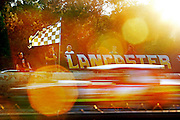 "The sun begins to set during a Saturday night of racing at Lancaster Super Speedway. ""This place is special because of the people that have come through the gate for 58 years,"" said track announcer Mark Huey. ""Racing around here is a passion for them. It's a way of life."" Racing"""
