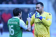 Lewis Stevenson and Ofir Marciano during the William Hill Scottish Cup 4th round match between Heart of Midlothian and Hibernian at Tynecastle Stadium, Gorgie, Scotland on 21 January 2018. Photo by Kevin Murray.