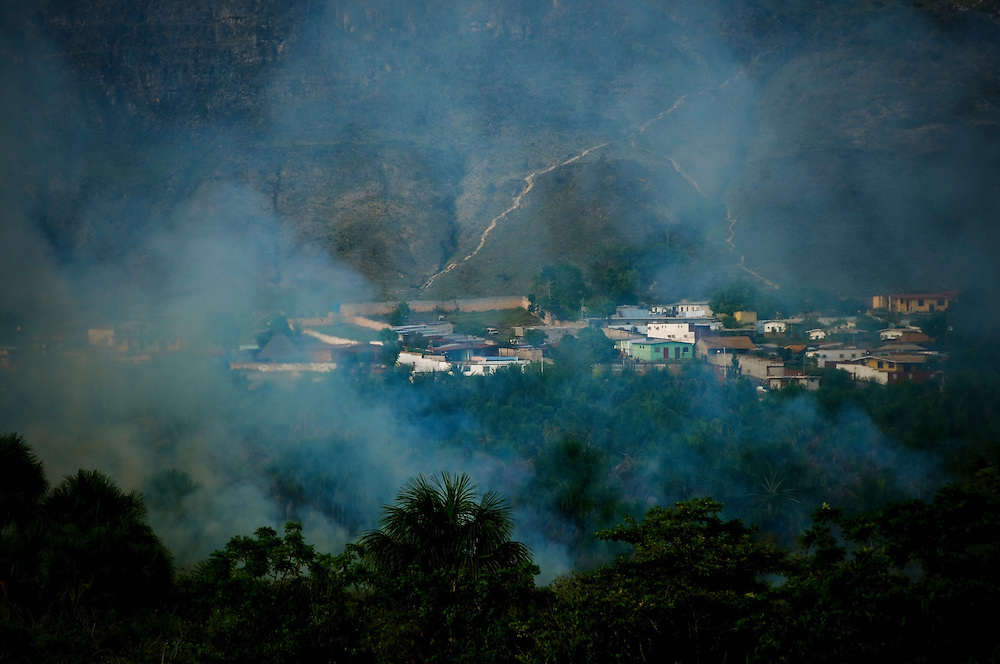 A fire burns in a primarily Pemón neighborhood on the outskirts of Santa Elena de Uairen in Venezuela's Gran Sabana. Pemón Indians indigenous to the region recognize fire setting as an integral part of their culture and maintain that the fires help prevent larger fires from naturally occurring, despite recommendations from environmentalists and critics that urge them to stop.