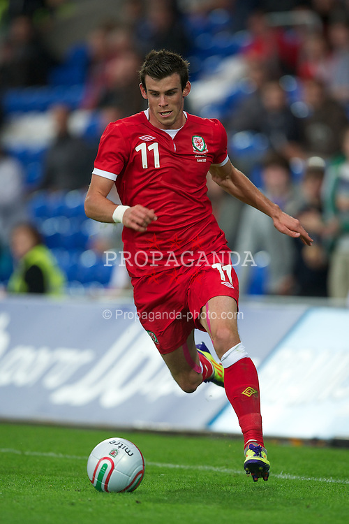 CARDIFF, WALES - Wednesday, August 10, 2011: Wales' Gareth Bale in action against Australia during an International Friendly match at the Cardiff City Stadium. (Photo by David Rawcliffe/Propaganda)