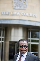 © Licensed to London News Pictures. 10/08/2015. Bradford, UK. Picture shows teacher Vincent Uzomah. A 14 year old boy has been sentenced at Bradford Crown Court for causing grievous bodily harm. The 14 year old who cannot be named stabbed supply teacher Vincent Uzomah in the stomach on June 11th at Dixons Kings Academy.<br /> Photo credit : Andrew McCaren/LNP