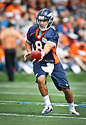 SHOT 7/25/13 9:43:59 AM - Denver Broncos rookie quarterback Ryan Katz #8 runs through drills during opening day of the team's training camp July 25, 2013 at Dove Valley in Englewood, Co.  (Photo by Marc Piscotty / © 2013)