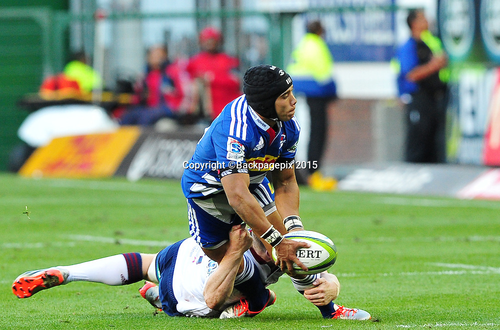Cheslin Kolbe the Stormers gets his pass away as Hamish Northcott of the Blues makes the tackle during the 2015 Vodacom Super Rugby game between the Stormers and the Blues at Newlands Rugby Stadium, Cape Town on 21 February 2015 ©Ryan Wilkisky/BackpagePix