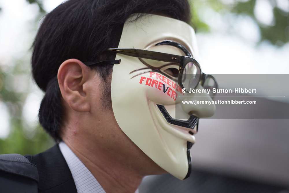 Approximately 60 participant activists (hacktivists) of the internet-freedom collective known as Anonymous, meet in Miyashita Park, to conduct a 'an offline cleaning operation', picking up litter, to raise awareness of their concerns over new Japanese copyright laws, in Tokyo, Japan, on Saturday 7 July 2012. The demonstrators wished to highlight their opposition to new laws which come into effect in October, in Japan, and which they say will threaten civil liberties on the internet.