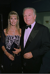 MR & MRS ROBERT SANGSTER the leading racehorse owner, at an exhibition in London on 1st October 1997.MBU 81