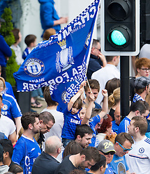 © Licensed to London News Pictures. 25/05/2015. London, UK. The Chelsea FC first team and manager Jose Morihno parade the 2014/15 Premier League trophy and the Capital One Cup through the streets of West London in an open top bus to celebrate their seasons achievements.  Photo credit: Ben Cawthra/LNP