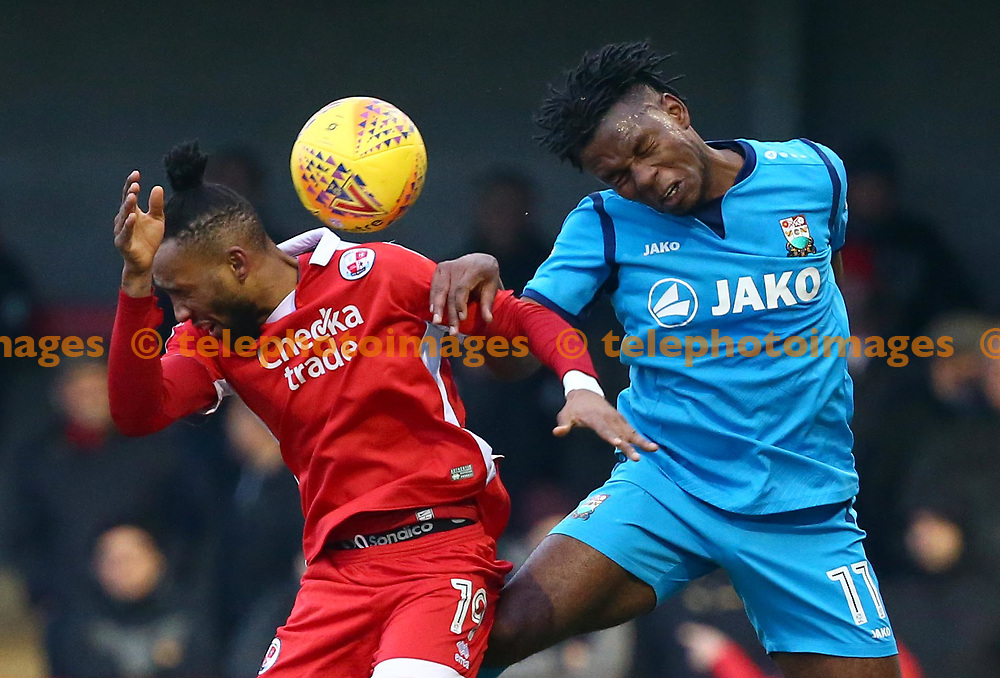 Shaquile Coulthirst of Barnet challenges Crawley's Cedric Evina  during the Sky Bet League 2 match between Crawley Town and Barnet at the Checkatrade Stadium in Crawley. 13 Jan 2018