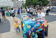 Artist Jessica Browne-White plays the piano she designed, one of the 88 Sing for Hope Pianos, supported by Chobani, Inc., at the Josie Robertson Plaza at Lincoln Center, Sunday, June 16, 2013. The event celebrates the conclusion of the Sing for Hope Pianos project, a two-week public art installation around the five boroughs of New York.  (Photo by Diane Bondareff/Invision for Sing for Hope)