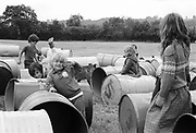 Children playing with bins, Glastonbury, Somerset, 1989