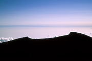 The summit of Mount Fuji seen in silhouette. Japan August 2005