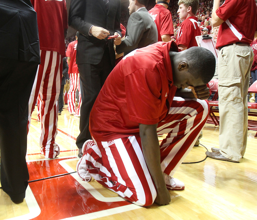 Indiana guard Victor Oladipo prays on the sidelines before the start of the game with Ohio State Saturday night in Bloomington. Indiana and Ohio State faced off at Assembly Hall Saturday, December 31, 2011. (Mike Fender / The Star)