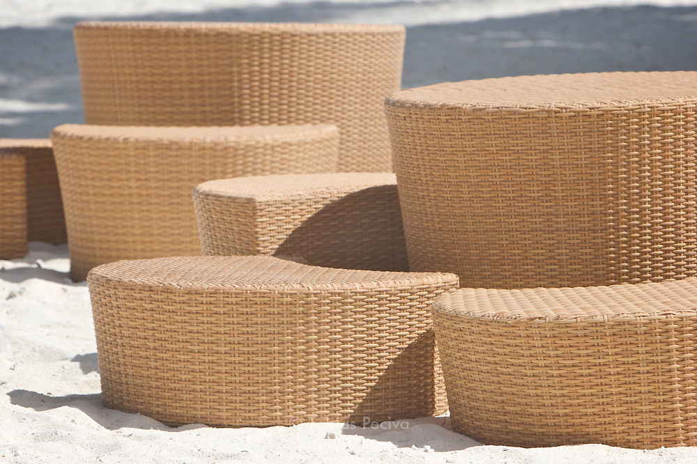 Rattan seating group on the beach at the Bora Bora Nui Resort & Spa. Previously a Starwood Luxury Collection property, the Bora Bora Nui is now operated by Hilton. Bora Bora is one of the Leeward Islands in the Society Islands archipelago of French Polynesia.