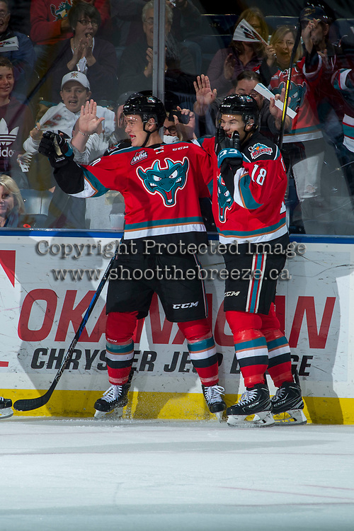 KELOWNA, CANADA - NOVEMBER 10: Conner Bruggen-Cate #20 and Carsen Twarynski #18 of the Kelowna Rockets celebrate a third period goal against the Vancouver Giants on November 10, 2017 at Prospera Place in Kelowna, British Columbia, Canada.  (Photo by Marissa Baecker/Shoot the Breeze)  *** Local Caption ***