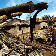 A man walks past destroyed houses in the village of Kpoto, Benin on Tuesday October 26, 2010.  Waters have receded in Kpoto, but most of the village was literally flattened by floods that have hit Benin over the past few weeks..