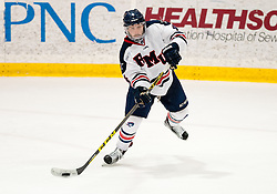 March 12 2016: Robert Morris Colonials defenseman Chase Golightly (4) makes a pass during the third period in game two of the Atlantic Hockey quarterfinals series between the Bentley Falcons and the Robert Morris Colonials at the 84 Lumber Arena in Neville Island, Pennsylvania (Photo by Justin Berl)