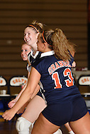 Middletown, N.Y. - Three SUNY Orange volleyball players celebrate after winning a point during a match against Dutchess Community College on Oct. 11, 2007.