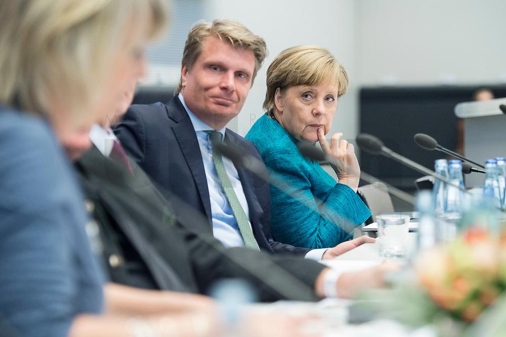 """24 APR 2017, BERLIN/GERMANY:<br /> Thomas Bareiss (L), MdB, CDU, Energiebeauftragter der CDU/CSU-BT-Fraktion, und Angela Merkel (R), CDU, Bundeskanzlerin, 9. Energiepolitischer Dialog der CDU/CSU-Fraktion im Deutschen Bundestag """"Spannungsfeld Energiewende - Die Energiewende wirtschaftlich gestalten"""", Fraktionssitzungssaal, Deutscher Bundestag<br /> IMAGE: 20170424-01-119<br /> KEYWORDS: Thomas Bareiß"""