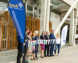 Pictured: <br /> <br /> Stillbirth and neonatal death charity  launched their awareness month campaign today in Edinburgh. The #15babiesaday drive by Sands aims to highlight the fact 15 babies a day in the UK die shortly before, during or after birth.  MSPs Neil Findlay, Kezia Dugdale, Angela Constance, Ian Gray among others joined bereaved parents at its Scottish Parliament launch today.<br /> <br /> Ger Harley   EEm 15 June 2017