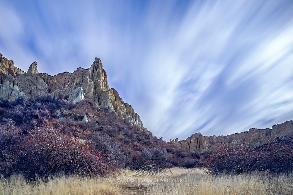 A long exposure of clouds streaking over the Clay Cliffs, Omarama, New Zealand.