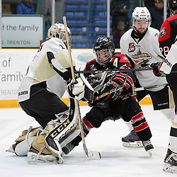 TRENTON, ON - APR 20,  2017: Ontario Junior Hockey League, Championship Series. Georgetown Raiders vs the Trenton Golden Hawks in Game 4 of the Buckland Cup Final. Jack Jacome #23 of the Georgetown Raiders and Chays Ruddy #4 of the Trenton Golden Hawks battle in front of Chris Janzen #1 of the Trenton Golden Hawks during the second period<br /> (Photo by Amy Deroche / OJHL Images)