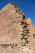 Pueblo Bonito is a monumental public building (Puebloan Great House) occupied from around 828 to 1126 AD, now preserved at Chaco Culture National Historical Park, New Mexico, USA. The huge D-shaped complex of Pueblo Bonito enclosed two plazas with dozens of ceremonial kivas, plus 600 rooms towering 4 and 5 stories above the valley floor. The functions of this building included ceremony, administration, trading, storage, hospitality, communications, astronomy, and burial, but few living quarters. Chaco Culture NHP hosts the densest and most exceptional concentration of pueblos in the American Southwest and is a UNESCO World Heritage Site, located in remote northwestern New Mexico, between Albuquerque and Farmington. From 850 AD to 1250 AD, Chaco Canyon advanced then declined as a major center of culture for the Ancient Pueblo Peoples. Chacoans quarried sandstone blocks and hauled timber from great distances, assembling fifteen major complexes that remained the largest buildings in North America until the 1800s. Climate change may have led to its abandonment, beginning with a 50-year drought starting in 1130.