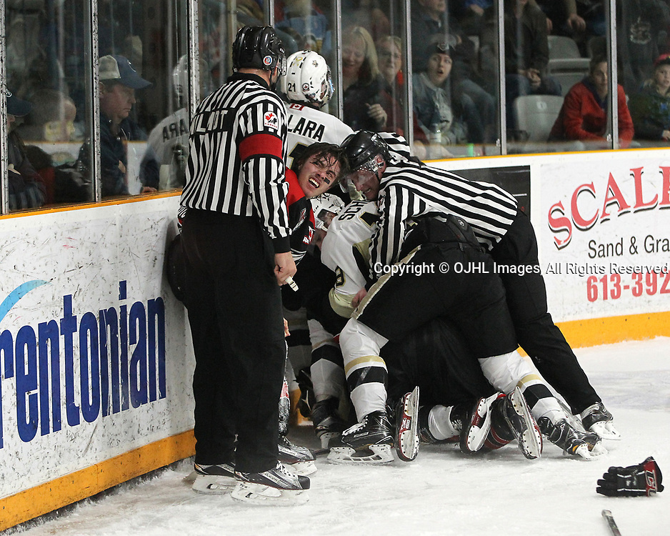 TRENTON, ON  - APR 15,  2017: Ontario Junior Hockey League, Championship Series. Georgetown Raiders vs the Trenton Golden Hawks in Game 2 of the Buckland Cup Final. Jack Jacome #23 of the Georgetown Raiders looks at the Referee during an altercation with the Trenton Golden Hawks players, during the third period.<br /> (Photo by Tim Bates / OJHL Images)