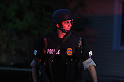13 September 2010: A member of Springfield Police Department's Special Response Team (SRT) is  illuminated by police lights near West State Street and Golden Avenue. SRT was called to a house containing a barricaded subject on Monday around 8 p.m. SRT would enter the house and the subject gave up without incident. Credit: David Welker/ Turfimages.com