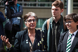 London, UK. 30th April 2019. Climate change activists from Extinction Rebellion (l-r) Farhana Yamin, Sam Knights and Felix Ottaway O'Mahony are interviewed outside the Home Office after attending a meeting hosted by the Secretary of State for the Environment Michael Gove.