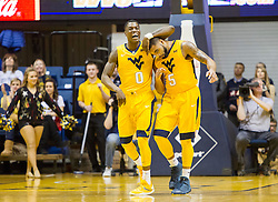 Dec 21, 2015; Morgantown, WV, USA; West Virginia Mountaineers guard Teyvon Myers (0) celebrates with guard Jaysean Paige (5) after scoring a three pointer during the first half at the WVU Coliseum. Mandatory Credit: Ben Queen-USA TODAY Sports