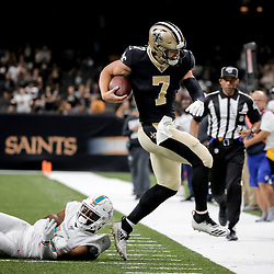 Aug 29, 2019; New Orleans, LA, USA; New Orleans Saints quarterback Taysom Hill (7) breaks away from Miami Dolphins cornerback David Rivers (46) during the second half of a preseason game at the Mercedes-Benz Superdome. Mandatory Credit: Derick E. Hingle-USA TODAY Sports