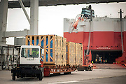 Workers unload 71 pieces of ProNova's equipment for a Cyclotron imaging unit that is used for cancer treatment from the WALLENIUS WILHELMSEN M.V. Tulane at the Georgia Ports Authority Ocean Terminal, Sunday August 10, 2014, in Savannah, Ga.  (GPA Photo/Stephen B. Morton)