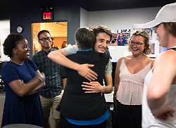 A reception was held for Rita Reed, photojournalism professor at the Missouri School of Journalism, to celebrate her retirement after 16 years of being on the faculty. <br /> <br /> In this photo, Reed gets hugs from her students after they presented a  card of thanks and appreciation.<br /> <br /> The event was held on May 10, 2017 in the Cliff and Vi Edom Photojournalism Lab in Lee Hills Hall on the University of Missouri campus in Columbia, Mo.<br /> <br /> The following is from Reed&rsquo;s bio posted on the Missouri School of Journalism website: &quot;Rita Reed joined the photojournalism faculty in 2001 after 20 years as a working photojournalist with Star Tribune in Minneapolis and The Gazette in Cedar Rapids, Iowa. She has worked not only on local, regional and national stories, but also internationally in Haiti, Bolivia, Colombia, Taiwan, China and the countries of the former Eastern Block.<br /> <br /> Reed holds a master&rsquo;s degree in journalism from the University of Missouri and an undergraduate degree from Southwest Missouri State University. She was the 1993 recipient of the Nikon Sabbatical Grant for Documentary Photography for the completion of work on a photographic book about gay and lesbian teenagers. Reed maintains an interest in and concern for adolescents and the issues they face. She is the director of the College Photographer of the Year competition.&rdquo;